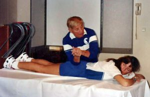 Bonnie giving myotherapy to a student