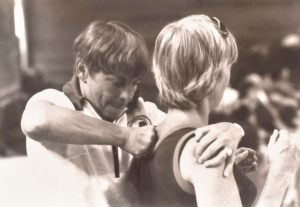 Bonnie Prudden giving myotherapy to a shoulder